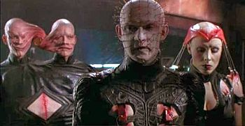 Pinhead, flanked by the Siamese Twins cenobite...